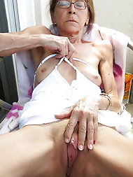 Insatiable mature lass is playing herself