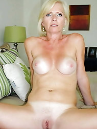 Sexual older mom is taking off her bra