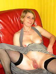 Fantastical mature granny is posing naked on picture