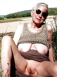 Shocking older tart is spreading pussy