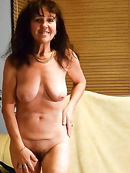 Chubby mature mama is posing at home