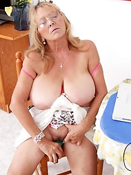 Passionate grandma Isabel lets her immense melons string up free and spreads her older legs