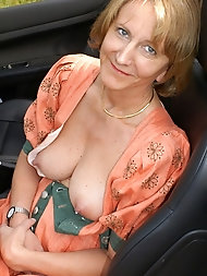 Mature damsel is taking off her bra