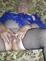 Desirable  granny is touching herself